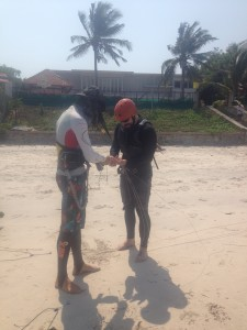 Nathan (in black) getting taught how to kiteboard by a Polish muay thai fighter (in white) in Thailand