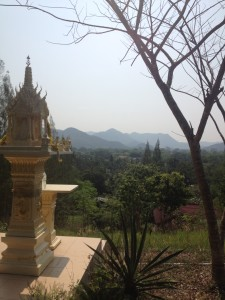 Mountains in Southern Thailand.  Families & Business all have these mini temples outside.